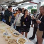 Delegates enjoy Indonesian snacks with delight.